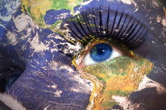 Womans face with planet Earth texture and nevada state flag inside the eye. Royalty Free Stock Image