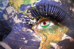 Womans face with planet Earth texture and niger flag inside the eye. Royalty Free Stock Images