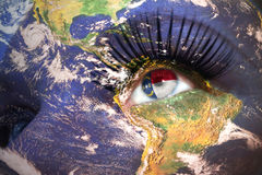 Womans face with planet Earth texture and north carolina state flag inside the eye. stock images