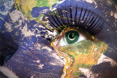 Womans face with planet Earth texture and pakistani flag inside the eye. Elements of this image furnished by NASA Royalty Free Stock Photo