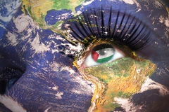 Womans face with planet Earth texture and palestinian flag inside the eye. Elements of this image furnished by NASA Stock Images