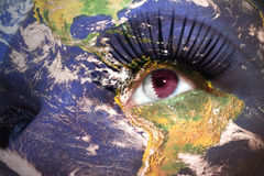 Womans face with planet Earth texture and qatar flag inside the eye. Elements of this image furnished by NASA Royalty Free Stock Photos