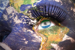 Womans face with planet Earth texture and sierra leone flag inside the eye. Elements of this image furnished by NASA Stock Images