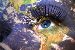Womans face with planet Earth texture and south carolina state flag inside the eye. Royalty Free Stock Images