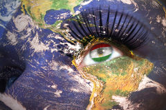 Womans face with planet Earth texture and tajikistan flag inside the eye. Elements of this image furnished by NASA Stock Photo