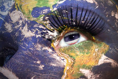 Womans face with planet Earth texture and thailand flag inside the eye. Elements of this image furnished by NASA Stock Images