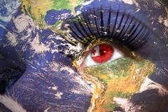 Womans face with planet Earth texture and tonga flag inside the eye. Elements of this image furnished by NASA Stock Photography