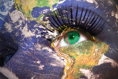 Womans face with planet Earth texture and turkmenistan flag inside the eye. Elements of this image furnished by NASA Stock Photos