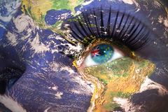 Womans face with planet Earth texture and tuvalu flag inside the eye. Elements of this image furnished by NASA Stock Images