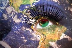 Womans face with planet Earth texture and vanuatu flag inside the eye. Elements of this image furnished by NASA Royalty Free Stock Images