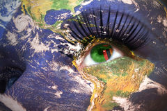 Womans face with planet Earth texture and zambian flag inside the eye. Royalty Free Stock Photo