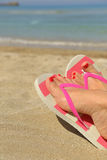 Womans feet with flip flops Royalty Free Stock Images