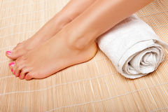 Womans feet with a rolled towel Royalty Free Stock Photos