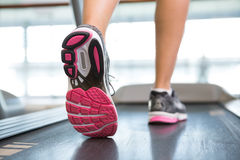 Womans feet running on the treadmill Royalty Free Stock Photo
