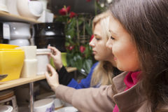 Womans in a flower shop Stock Images