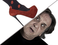 A woman's foot crushing man's head Royalty Free Stock Photography