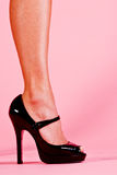 Womans Foot in Patent High Heels. On a Pink Background royalty free stock photo