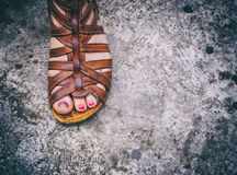 Womans foot. Photograph of a womans foot with a sandal Stock Photos