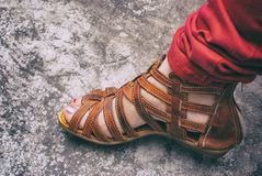 Womans foot. Photograph of a womans foot with a sandal Royalty Free Stock Images