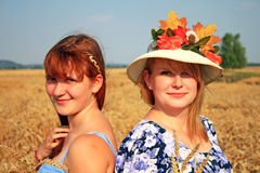 Womans in golden wheat Stock Photography