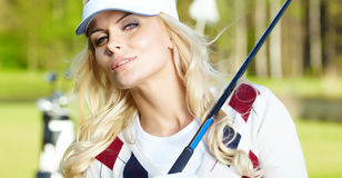 Womans golf. On green grass Royalty Free Stock Image