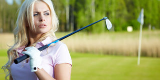 Womans golf. On green grass Stock Photos