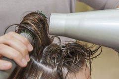 Womans hair being blow dried Stock Images