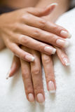 Womans hand. S with a french manicure on the towel Royalty Free Stock Photography
