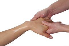 Womans hand being massaged Royalty Free Stock Images