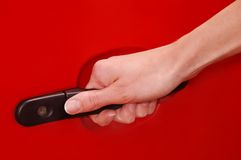 Womans hand on car handle stock images