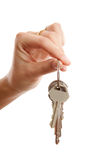 Womans hand gives you the keys Stock Photo