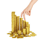 Womans hand with gold coins on white Stock Images