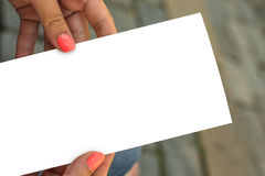 Womans hand holding blank piece of paper Stock Images