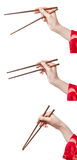 Womans hand holding chopsticks Stock Image