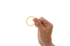 Womans hand holding a condom Royalty Free Stock Photography