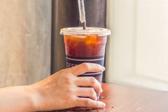 Womans hand holding iced coffee in takeaway cup. Womans hand holding iced coffee in takeaway cup, coffee break Royalty Free Stock Photos