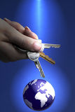 Womans Hand Holding Keys To The World. Concept photo stock photography