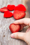 Womans hand holding  a red heart shape. Royalty Free Stock Photos
