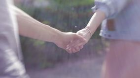 Womans hand leading a man forward to the adventure in the city. Follow me concept. Portrait. Outside shooting, windy stock footage