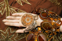 Womans hand mehendi picture orange bright fabric embroidery Royalty Free Stock Photography