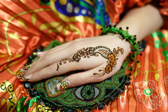 Womans hand mehendi picture orange bright fabric with pleats. Indian picture on lady hand, mehendi art tradition decoration, resistant design by special paint Royalty Free Stock Photography