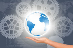 Womans hand with planet. On abstract background with cog wheels Stock Photography