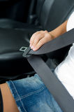 Womans hand with seat belt in the car royalty free stock photos