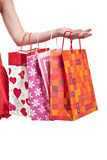 Womans hand with shopping bags Royalty Free Stock Photo