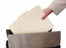 Womans hand thowing blank file into trash Royalty Free Stock Photos