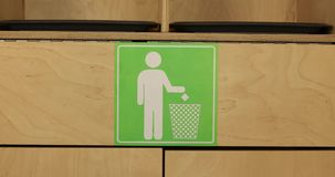 Womans hand throws paper debris into trash. Cropped portrait of someone tossing piece of paper in trash close up stock video footage