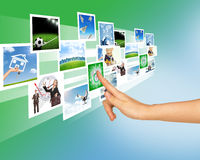 Womans hand touching holographic pictures Stock Images