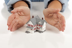Womans Hands Around Model House. On White Surface Royalty Free Stock Images