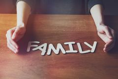 Womans hands with Family word Royalty Free Stock Photography
