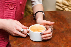 Womans hands hold a cup of coffee Royalty Free Stock Photo